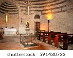 Small photo of Italy, Siena, Chiusdino, March 2017 inside the chapel of San Galgano in Montesiepi where it is preserved The sword in the rock fixed by Galgano in 1180 as a sign of renunciation of social life