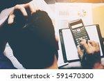 stress businessman and graph... | Shutterstock . vector #591470300