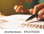Small photo of Hand woman holding pen pointing on summary report chart and calculate finance.