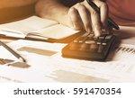 calculator and businesswoman... | Shutterstock . vector #591470354