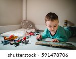 little boy reading for his toys ...   Shutterstock . vector #591478706