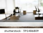 empty wooden desk space over... | Shutterstock . vector #591486809