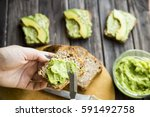 spread with a knife on a paste... | Shutterstock . vector #591492758