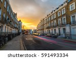 block of flats at sunset and... | Shutterstock . vector #591493334