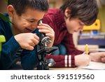 closeup of little boy using... | Shutterstock . vector #591519560
