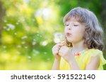 happy child blowing dandelion... | Shutterstock . vector #591522140