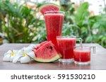 watermelon on wood background. | Shutterstock . vector #591530210