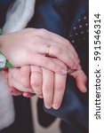 Small photo of Wedding Pic. Wedding couple holding hands