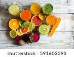 fresh detox juices from fruit... | Shutterstock . vector #591603293