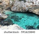small beach clear water | Shutterstock . vector #591623840