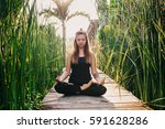 young woman practicing yoga... | Shutterstock . vector #591628286