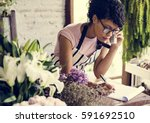 business of flower shop with... | Shutterstock . vector #591692510