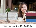 young pretty chinese woman... | Shutterstock . vector #591769394