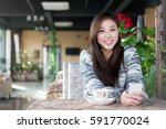 young pretty chinese woman... | Shutterstock . vector #591770024