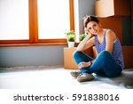 woman in a new home with... | Shutterstock . vector #591838016