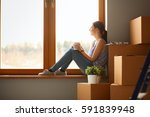 girl sitting on windowsill at... | Shutterstock . vector #591839948