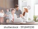 young happy businesspeople in... | Shutterstock . vector #591849230