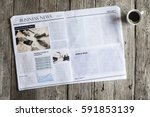 newspaper on wooden table | Shutterstock . vector #591853139