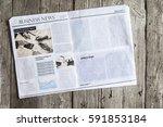 newspaper on wooden table | Shutterstock . vector #591853184
