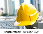 yellow safety helmet  | Shutterstock . vector #591854669