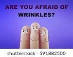Small photo of Three fingers decorated as three old people with wrinkles on face. Are you afraid of wrinkles?
