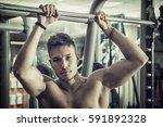 muscular  shirtless young man... | Shutterstock . vector #591892328