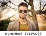 handsome young man walking... | Shutterstock . vector #591893789