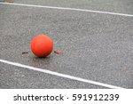 orange soccer ball on asphalt   Shutterstock . vector #591912239