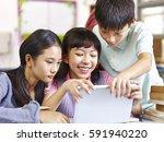 three happy asian elementary... | Shutterstock . vector #591940220