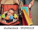 baby sleeping in carriage | Shutterstock . vector #591945119