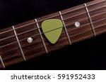 green guitar pick on the... | Shutterstock . vector #591952433