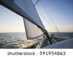 luxury boat sailing in sea... | Shutterstock . vector #591954863