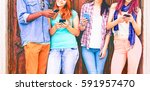 group of teenagers texting ... | Shutterstock . vector #591957470