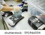 hands of worker who marks...   Shutterstock . vector #591966554
