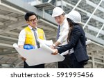 group of asian architects... | Shutterstock . vector #591995456