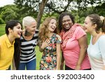 group of women socialize... | Shutterstock . vector #592003400