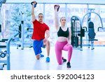 fitness instructor at the gym | Shutterstock . vector #592004123