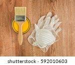 yellow paint can with brush and ... | Shutterstock . vector #592010603