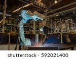 industrial robot is welding... | Shutterstock . vector #592021400
