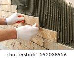 installing the tiles on the... | Shutterstock . vector #592038956