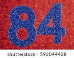 Small photo of Number eighty-four blue color over a red background. Anniversary. Horizontal