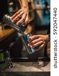 bartender making alcoholic... | Shutterstock . vector #592047440