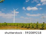 wind turbine on the blue sky... | Shutterstock . vector #592089218
