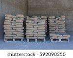 cement bag placed neatly in the ... | Shutterstock . vector #592090250