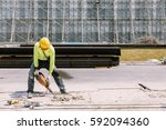 Construction worker  electric drill Drilling concrete ground in construction area - stock photo