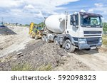 concrete mixer truck is pouring ... | Shutterstock . vector #592098323