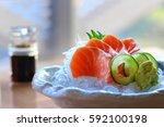 salmon sashimi | Shutterstock . vector #592100198