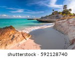 beach at caribbean sea in playa ... | Shutterstock . vector #592128740