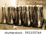 old bottles in wooden boxes | Shutterstock . vector #592155764