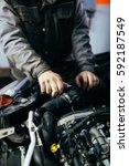auto mechanic repairing car.... | Shutterstock . vector #592187549
